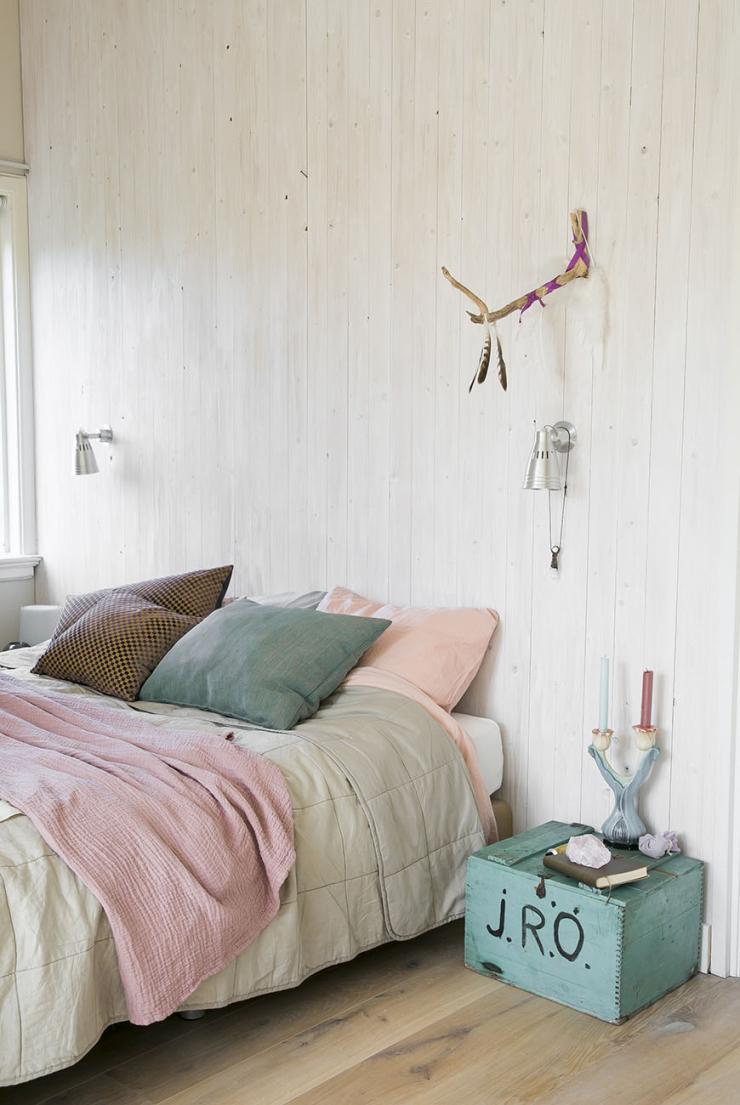 Leuk je slaapkamer op met hout op de muur